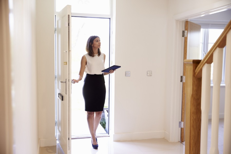 Female estate agent at property valuation